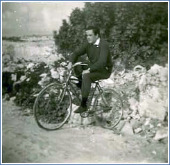 Young Roland on the bicycle.