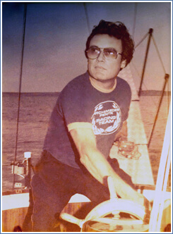 A younger Roland at the helm
